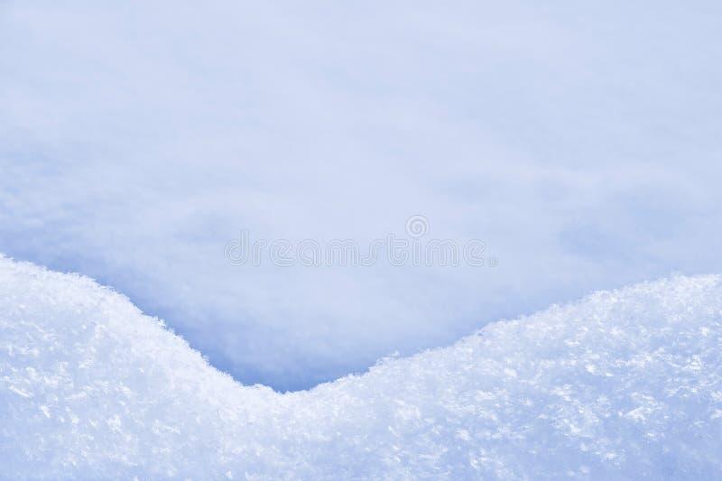 Detalle de la nieve acumulada por la ventisca - textura de la nieve fotos de archivo libres de regalías