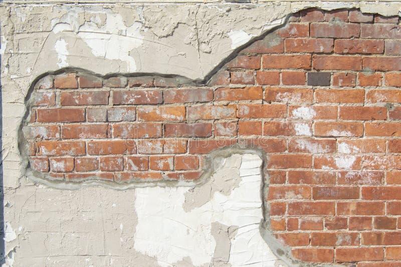 Detalle de la pared del ladrillo y del estuco foto de archivo