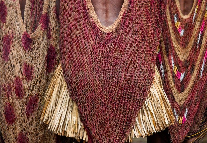Detalle de la tribu de Dani de la ropa del ` s de las mujeres imagenes de archivo