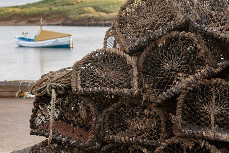 Detalle de las trampas de la langosta apiladas en un puerto fotografía de archivo libre de regalías