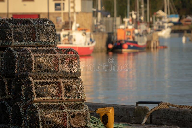 Detalle de las trampas de la langosta apiladas en un puerto Concepto de la industria pesquera imagen de archivo libre de regalías