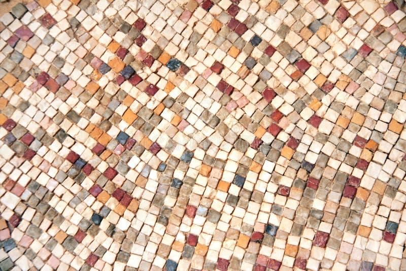 Detalle de los mosaicos de piedra naturales bizantinos antiguos de la teja fotos de archivo libres de regalías