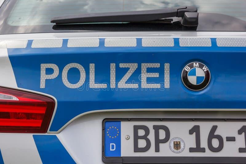 Detalle de un coche policía alemán fotos de archivo