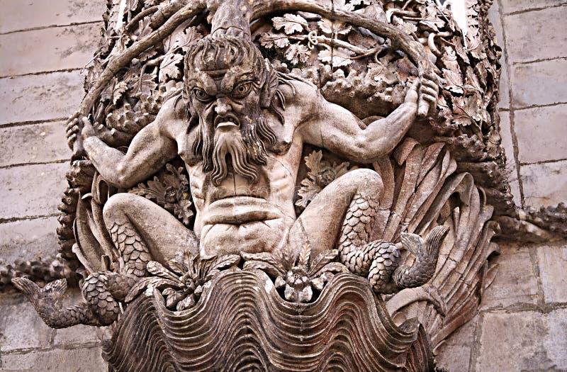 Detalle de una estatua, la pintura de un tritón mitológico foto de archivo libre de regalías