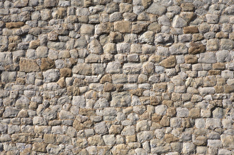 Detalle de una pared de piedra fotos de archivo