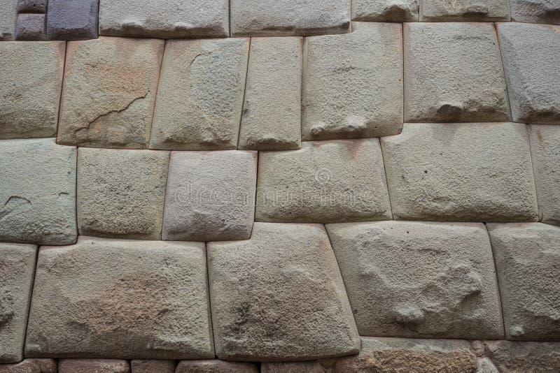Detalle de una pared del inca en la ciudad de Cuzco, Perú foto de archivo libre de regalías