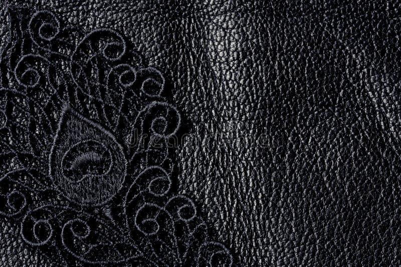 Detalle del cordón negro en el cuero foto de archivo