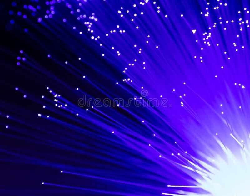 Detalle del manojo cada vez mayor azul de fondo de las fibras ópticas, rápido fotografía de archivo libre de regalías