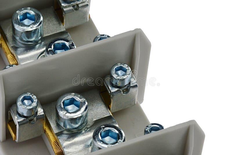 Detalle del terminal protector del conductor de la vinculación con los tornillos de Allen de los diversos diámetros y del bastido imagen de archivo libre de regalías