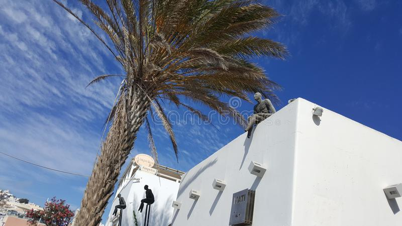 Detalles de la palma del viaje de Santorini imagenes de archivo