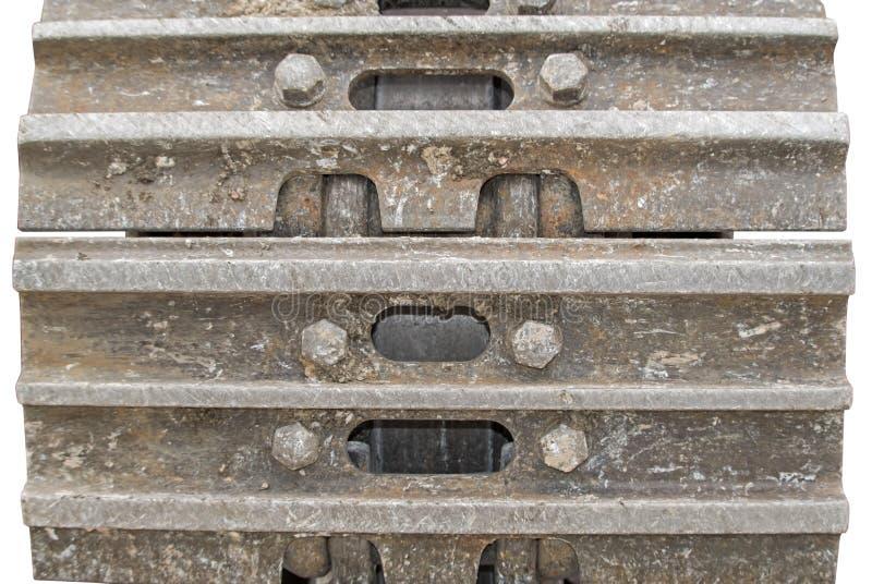 Detalles de las pistas de oruga aherrumbradas de una grúa móvil imagen de archivo