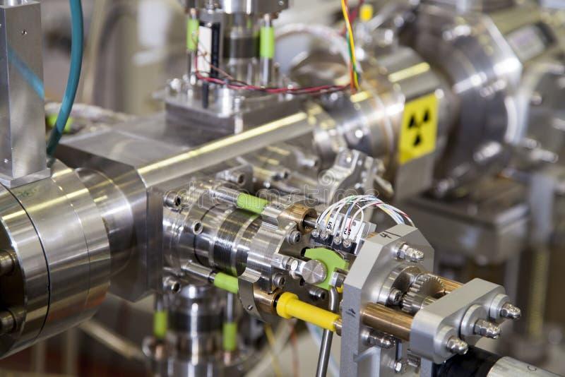 Detalles del acelerador de ION con la señal de peligro de la radiación fotografía de archivo libre de regalías