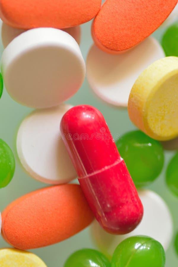 Detalles macros de la píldora y de tabletas médicas imagenes de archivo