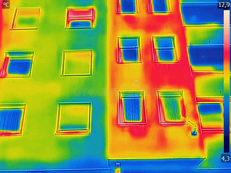 Detecting Heat Loss Outside building. Using Infrared Thermal Camera stock photo