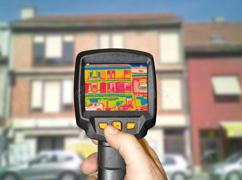 Detecting Heat Loss Outside building. Using Thermal Camera royalty free stock photos
