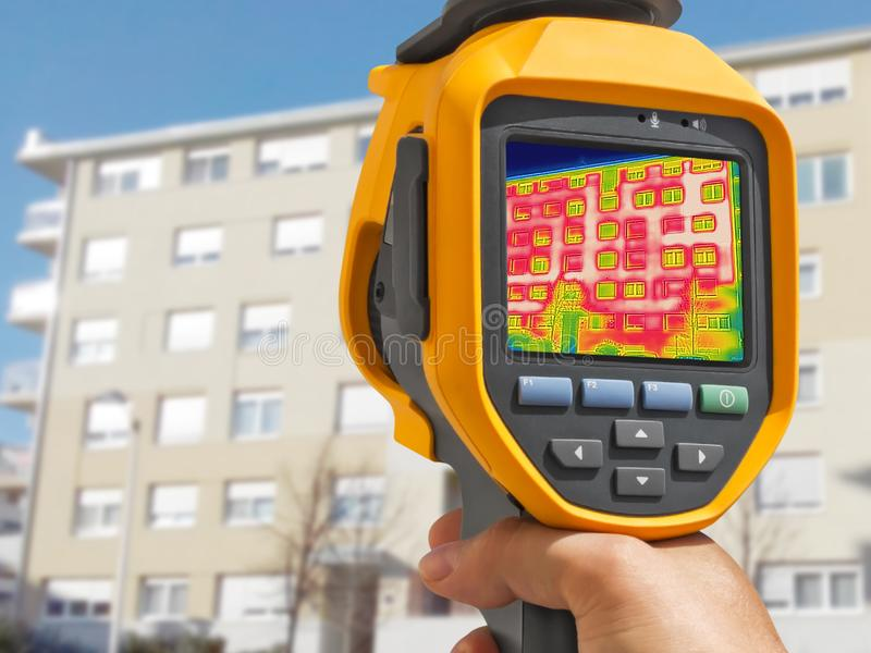 Detecting Heat Loss Outside building. Using Thermal Camera stock photography