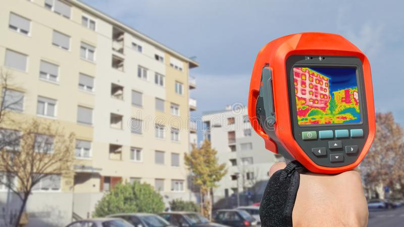 Detecting Heat Loss Outside building. Using Thermal Camera royalty free stock photo