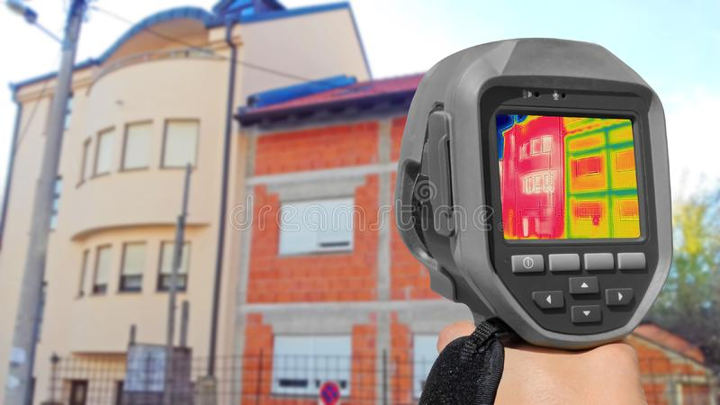Detecting Heat Loss Outside building Using Thermal Camera. Detecting Heat Loss on the building with or without isolation royalty free stock image