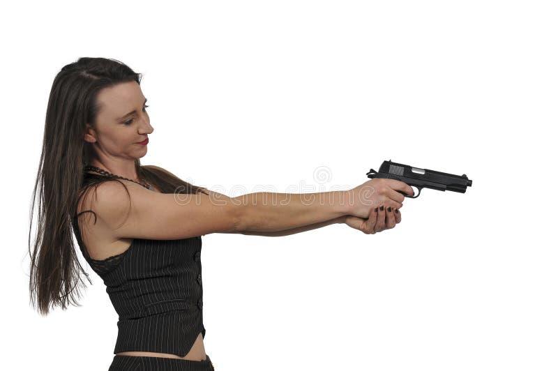 Detective de sexo femenino con el arma imágenes de archivo libres de regalías
