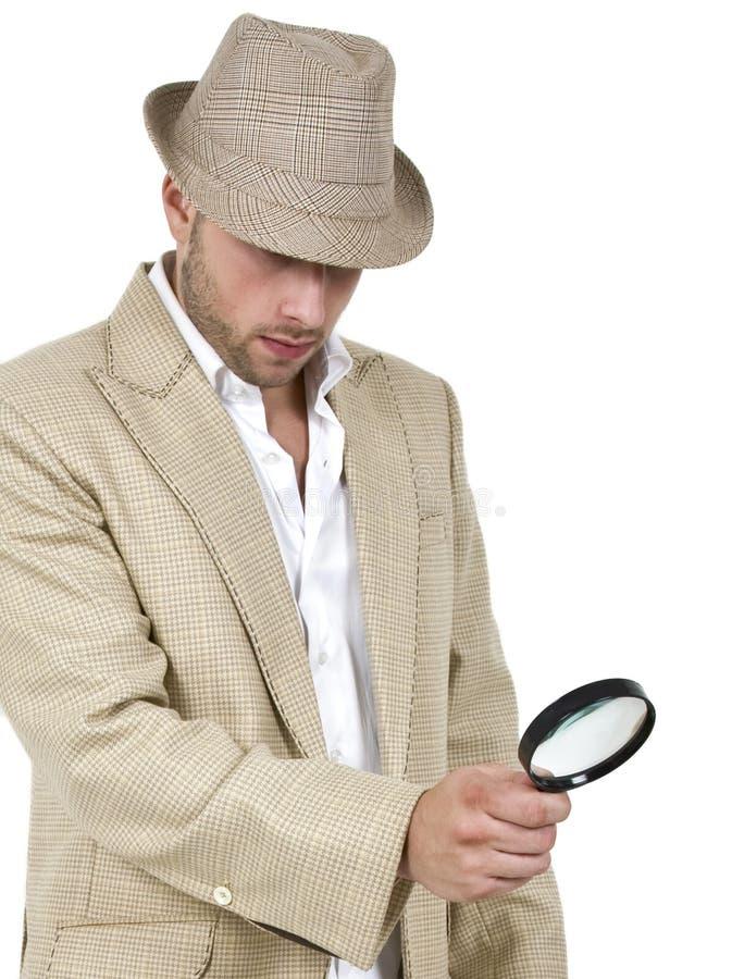 Detective en meer magnifier royalty-vrije stock afbeelding