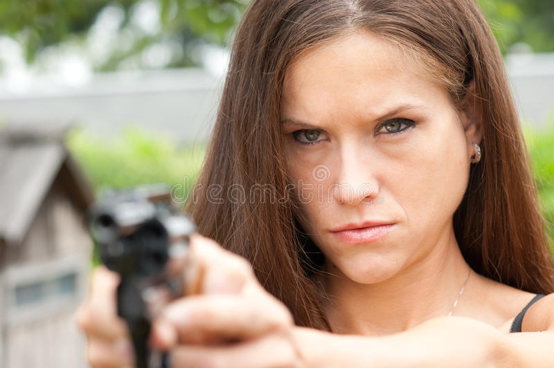 Determined Detective Girl Points Revolver stock photos