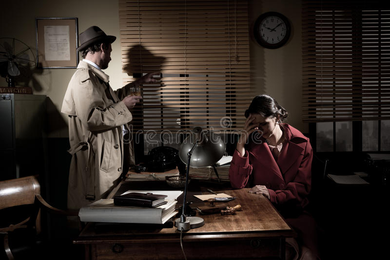 Detective giving bad news stock images