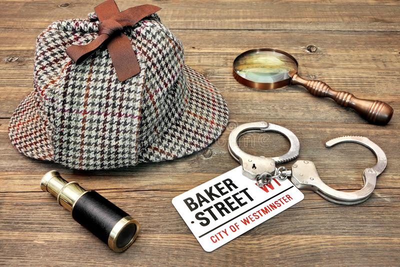 Detective Hat, Spyglass and Magnifier, sign Baker Street and han royalty free stock image