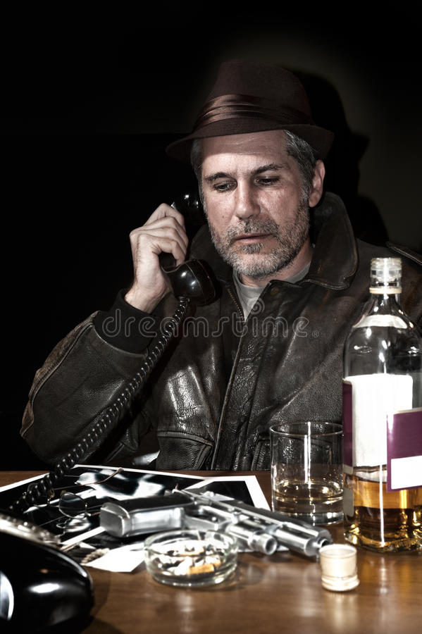 Detective in his office stock images