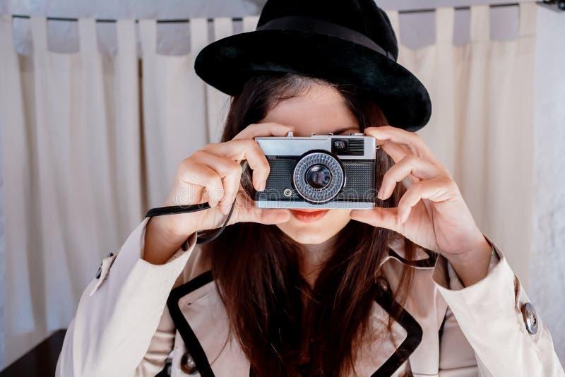 Detective woman taking photo stock image