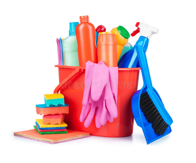 Detergent bottles, brushes, gloves and sponges in bucket royalty free stock images