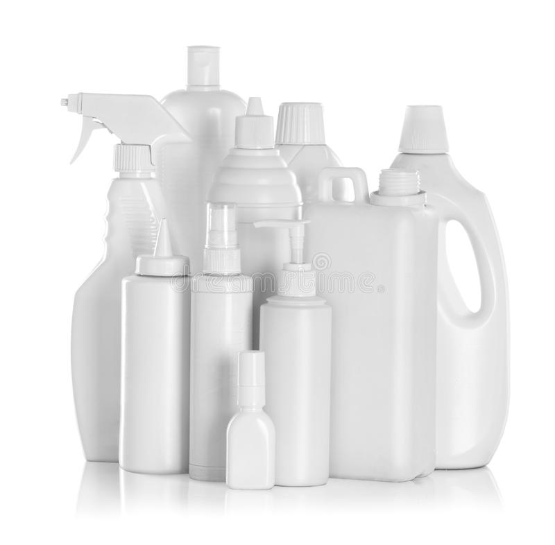 Detergent bottles and chemical cleaning supplies. Isolated on white stock photography