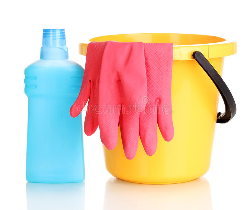 Detergent and bucket with gloves stock photos