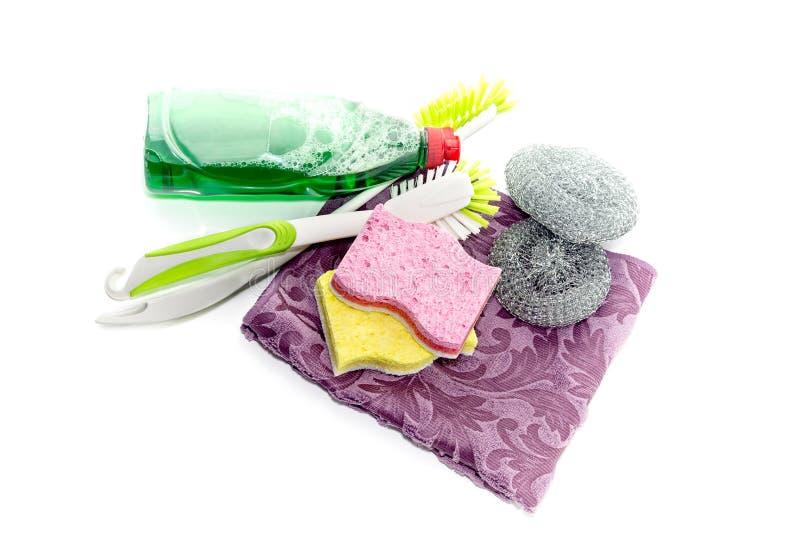 Detergent i washcloths na białym tle obraz stock