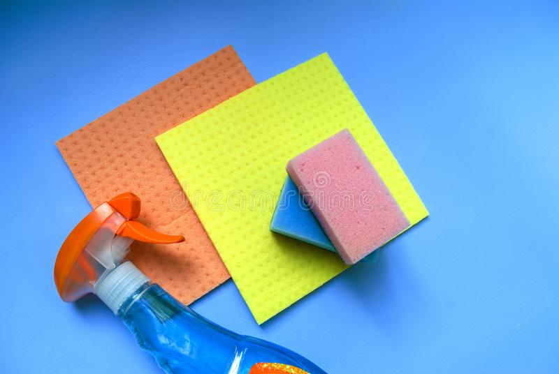 Detergent and washcloth on a blue background royalty free stock image