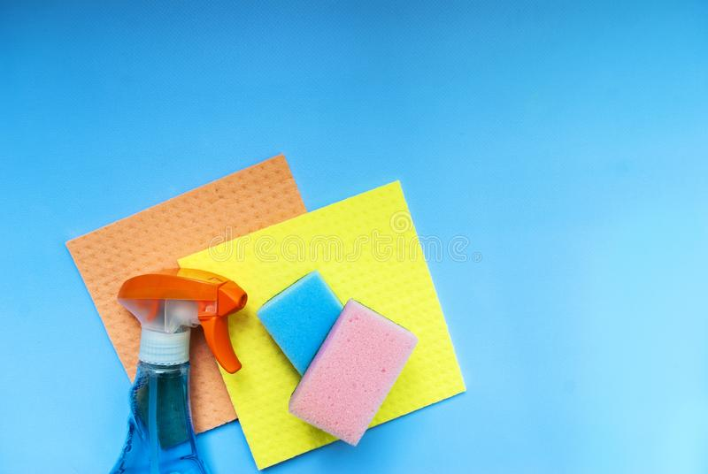 Detergent and washcloth on a blue background stock image