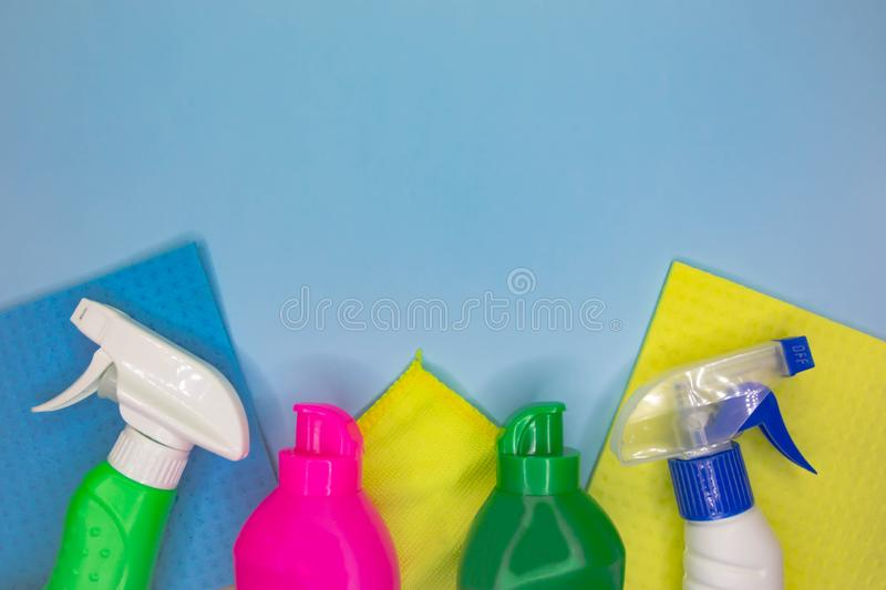 Detergents and cleaning accessories in blue color. Cleaning service, small business idea. royalty free stock images