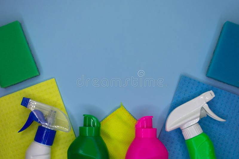 Detergents and cleaning accessories in blue color. Cleaning service, small business idea royalty free stock photos