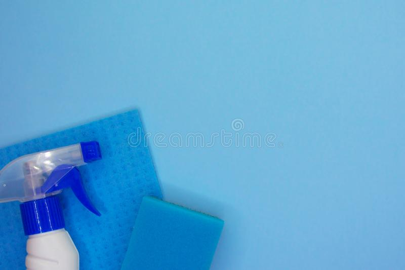 Detergents and cleaning accessories in blue color. Cleaning service, small business idea stock photos