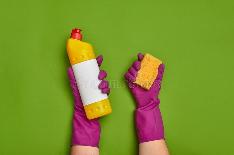 Detergents and cleaning accessories on a green background. Housekeeping concept. royalty free stock photography