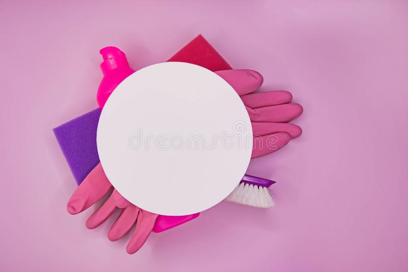 Detergents and cleaning accessories in pink color. Cleaning service, small business idea. stock photo
