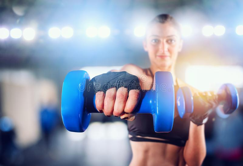 Determinated girl at the gym ready to start fitness lesson stock images