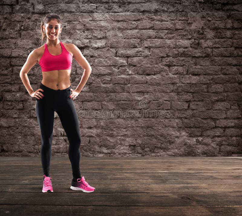 Determinated girl at the gym ready to start fitness lesson stock photos