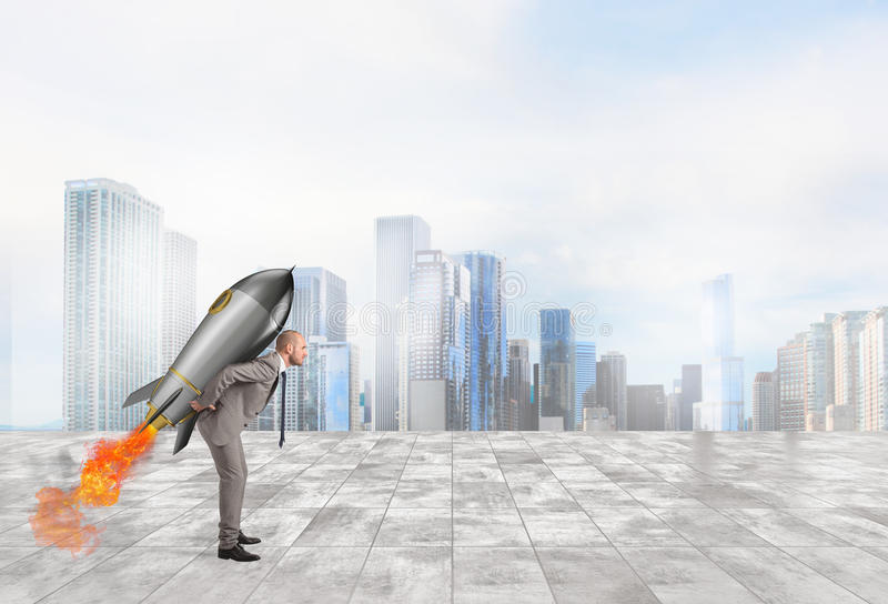 Determination and power businessman that holds a rocket. Businessman holding a missile on his shoulders stock photography