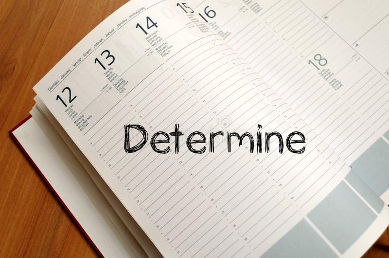 Determine escreve no caderno foto de stock