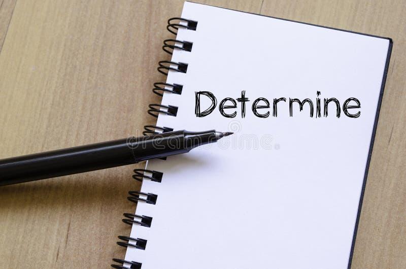 Determine escreve no caderno imagens de stock