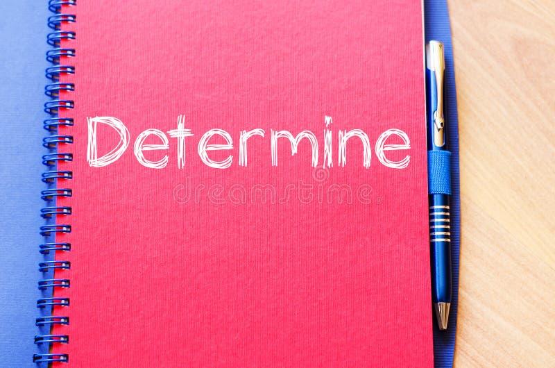 Determine escreve no caderno imagem de stock