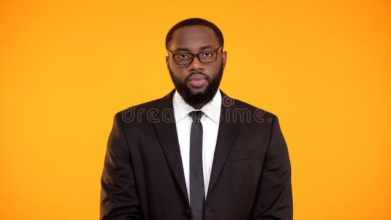 Determined african-american male in suit looking to camera, department leader royalty free stock photos