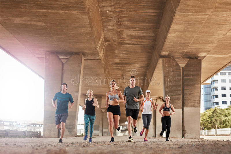 Determined group of young people running in city royalty free stock photos