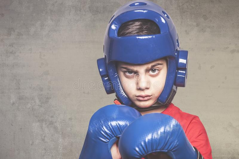 Martial arts concept. Determined little boy ready to fight royalty free stock image