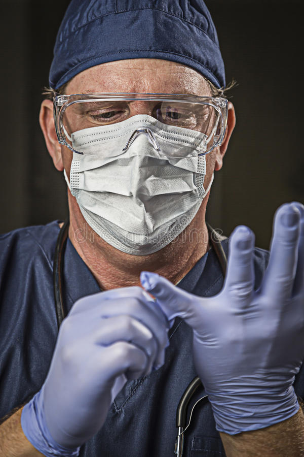 Determined Looking Doctor or Nurse with Protective Wear and Stet. Determined Looking Male Doctor or Nurse with Protective Wear and Stethoscope royalty free stock photography